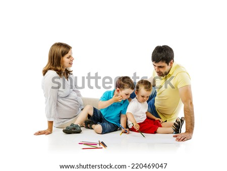 Portrait of the happy family with two children and pregnant mother drawing, isolated on white background - stock photo