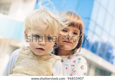 portrait of the  little boy and girl - stock photo