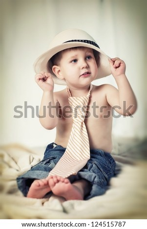 Portrait of the little boy with hat on head - stock photo
