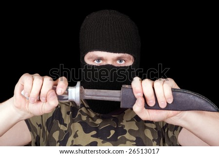 Portrait of  the man with a knife over black - stock photo