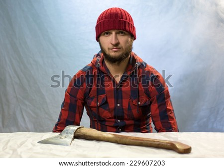 Portrait of the man with an axe - stock photo