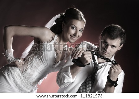portrait of the newlyweds on studio shooting - stock photo