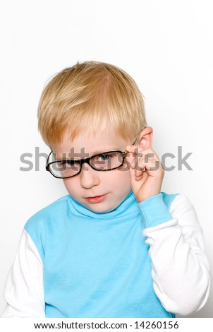 Portrait of the nice boy in glasses - stock photo