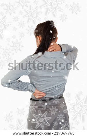 Portrait of the painful back of a businesswoman against snowflakes - stock photo