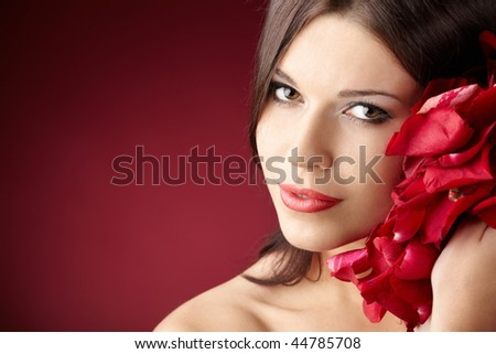 Portrait of the pretty girl with the red petals, isolated - stock photo