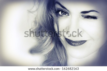 Portrait of the pretty smiling girl close-up - stock photo
