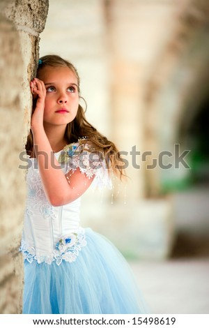 Portrait of the pretty young girl in a white dress. - stock photo