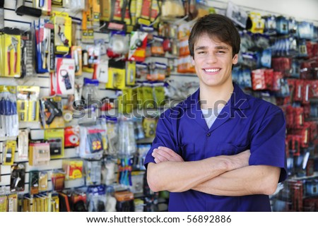 portrait of the proud owner of a home improvement stores with tools in the background - stock photo