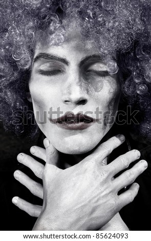 Portrait of the sad clown with closed eys - stock photo