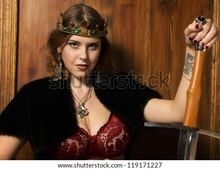 Portrait of the sexy woman in a medieval castle interior - stock photo