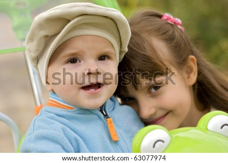 portrait of the sister with the younger brother - stock photo