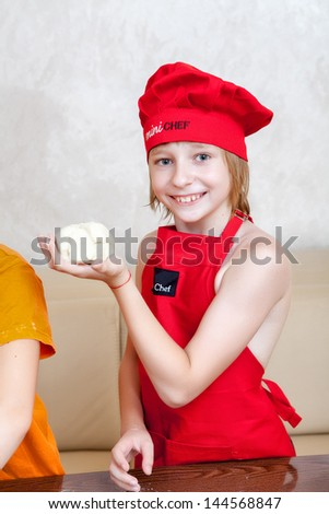 portrait of the small cook in work - stock photo