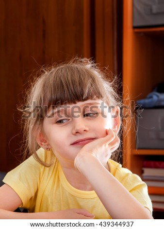 Portrait of the Small Girl in the Domestic Room - stock photo