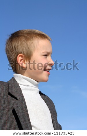 portrait of the smiling child boy outdoor - stock photo