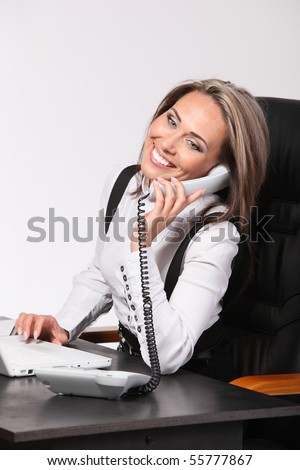 Portrait of the Smiling young business woman calling by phone - stock photo