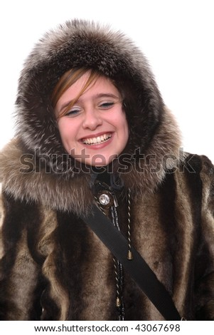 Portrait of the teenager in a fur coat and a cap - stock photo