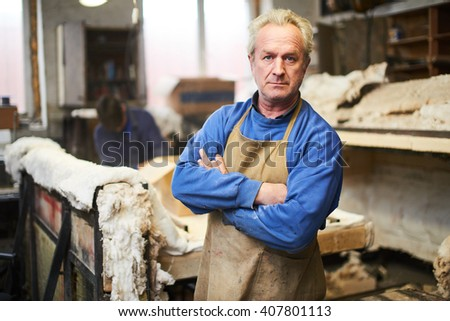 Portrait of the wizard in workshop for making glass - stock photo