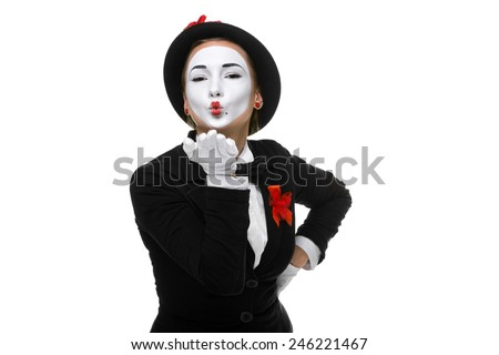 Portrait of the woman as mime sending a kiss isolated on white background. Concept of love - stock photo