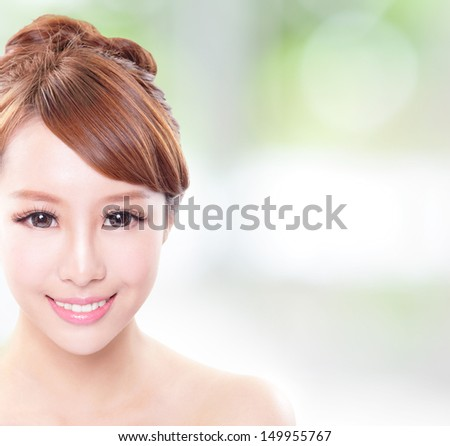 portrait of the woman with beauty face and perfect skin and health teeth isolated on green background, with copy space in the image, asian model - stock photo