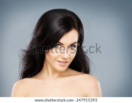 Portrait of the young, beautiful and cute girl with a blowing brunette hair. - stock photo