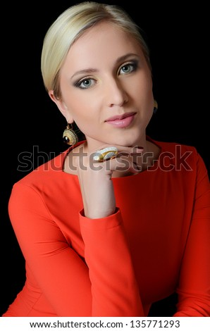 Portrait of the young beautiful girl on black - stock photo