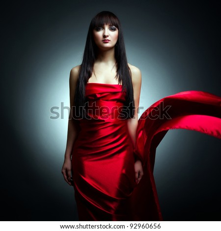 Portrait of the young beautiful woman with flying fabric - stock photo
