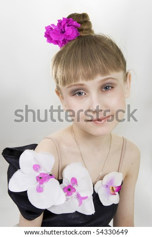 Portrait of the young dancer to a white background - stock photo