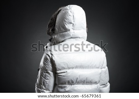 Portrait of the young man in a white jacket - stock photo