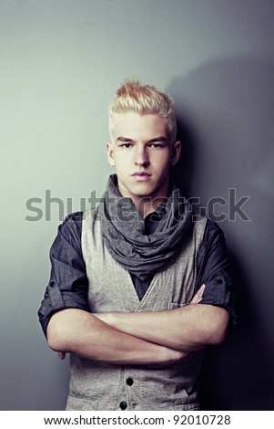 Portrait of the young man in fashionable clothes - stock photo
