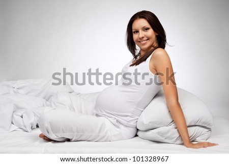 Portrait of the young pregnant girl - stock photo