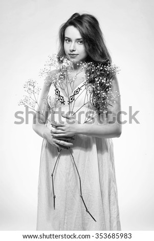 Portrait of the young  smiling pregnant woman. Black and white - stock photo