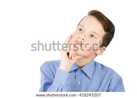 Portrait of the young teen boy. He is standing and looking up pensively and think. His hand at the chin. Isolated on white - stock photo
