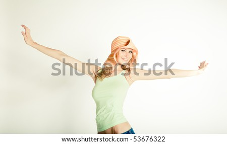 portrait of the young woman with hat - stock photo