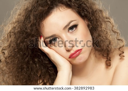 portrait of thoughtful and sad young woman - stock photo