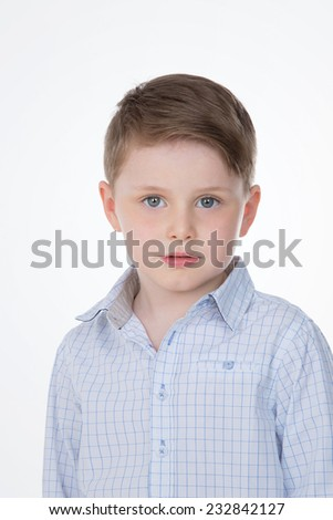 portrait of thoughtful and serious child - stock photo