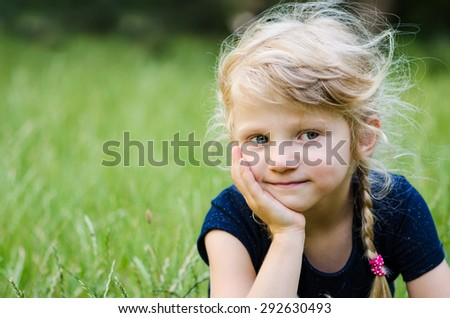 portrait of thoughtful blond girl with braided hair - stock photo