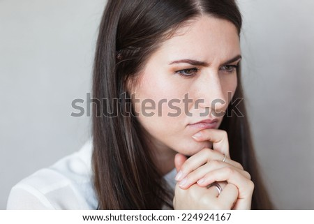 portrait of thoughtful business lady - stock photo