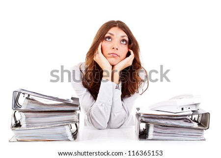 Portrait of thoughtful business woman looking up - stock photo