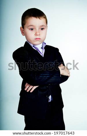 Portrait of thoughtful little boy looking down - stock photo