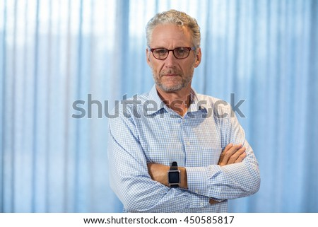 Portrait of thoughtful man in office - stock photo