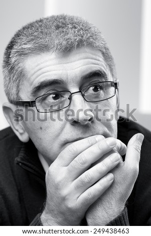 Portrait of thoughtful man looking away, black and white photo. - stock photo