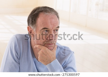 portrait of thoughtful middle aged man looking away - stock photo