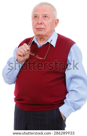 Portrait of thoughtful senior old teacher man, holds glasses in hand, wearing cardigan marsala color and shirt, isolated on white background. Human emotions and facial expressions. Education concept - stock photo