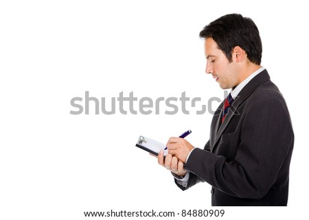 Portrait of thoughtful young business man taking notes against white background - stock photo