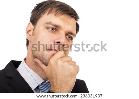 Portrait of  thoughtful young businessman isolated over white background  - stock photo