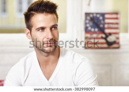 Portrait of thoughtful young handsome man looking away. - stock photo