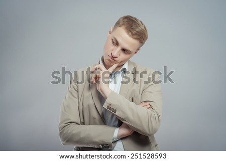 Portrait Of Thoughtful Young Man. Isolated on a gray background - stock photo