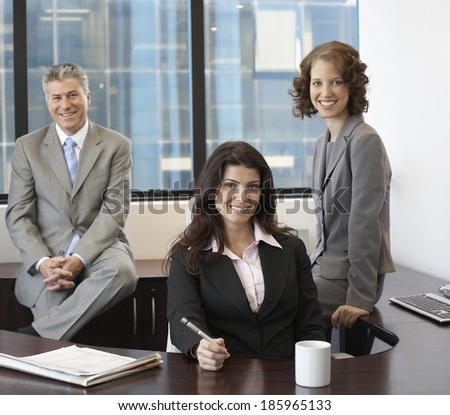 Portrait of three businesspeople in office - stock photo