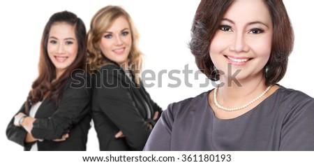 portrait of  three businesswoman smiling to camera - stock photo
