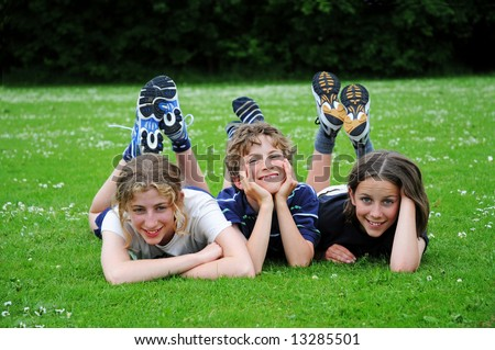 portrait of three children in park - stock photo